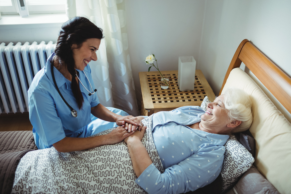 Female nurse talking to a patient